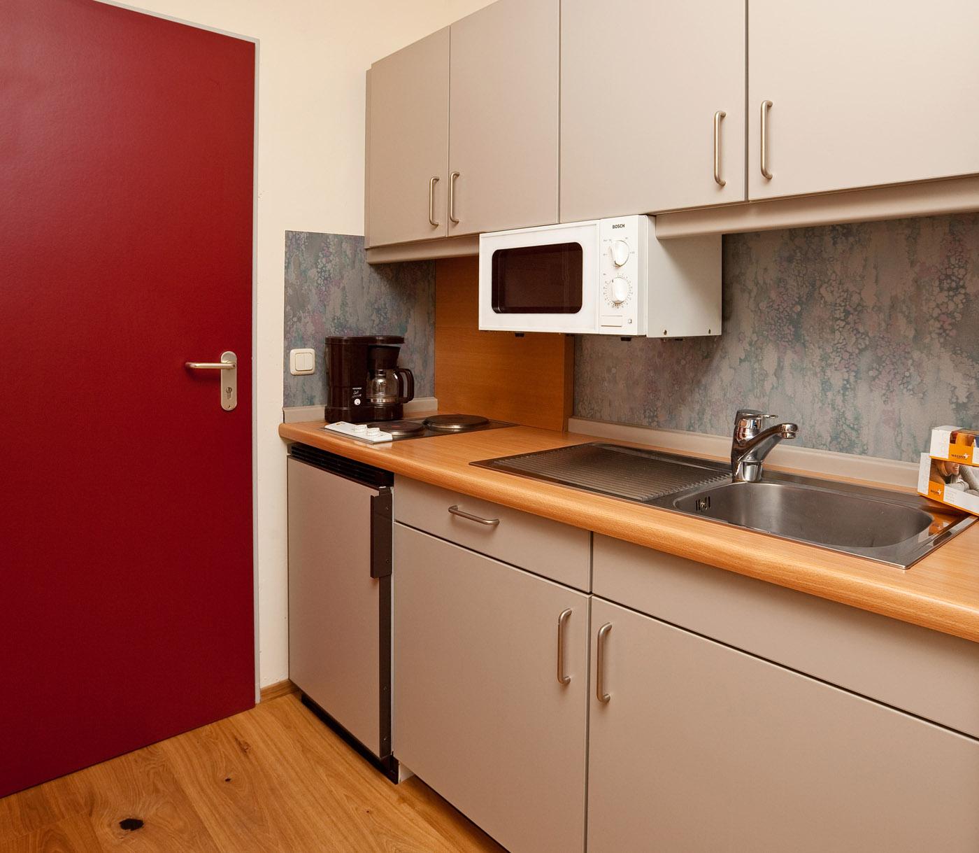 Kitchen in the 1-room-apartment at the aparthotel Seespitz in Füssen